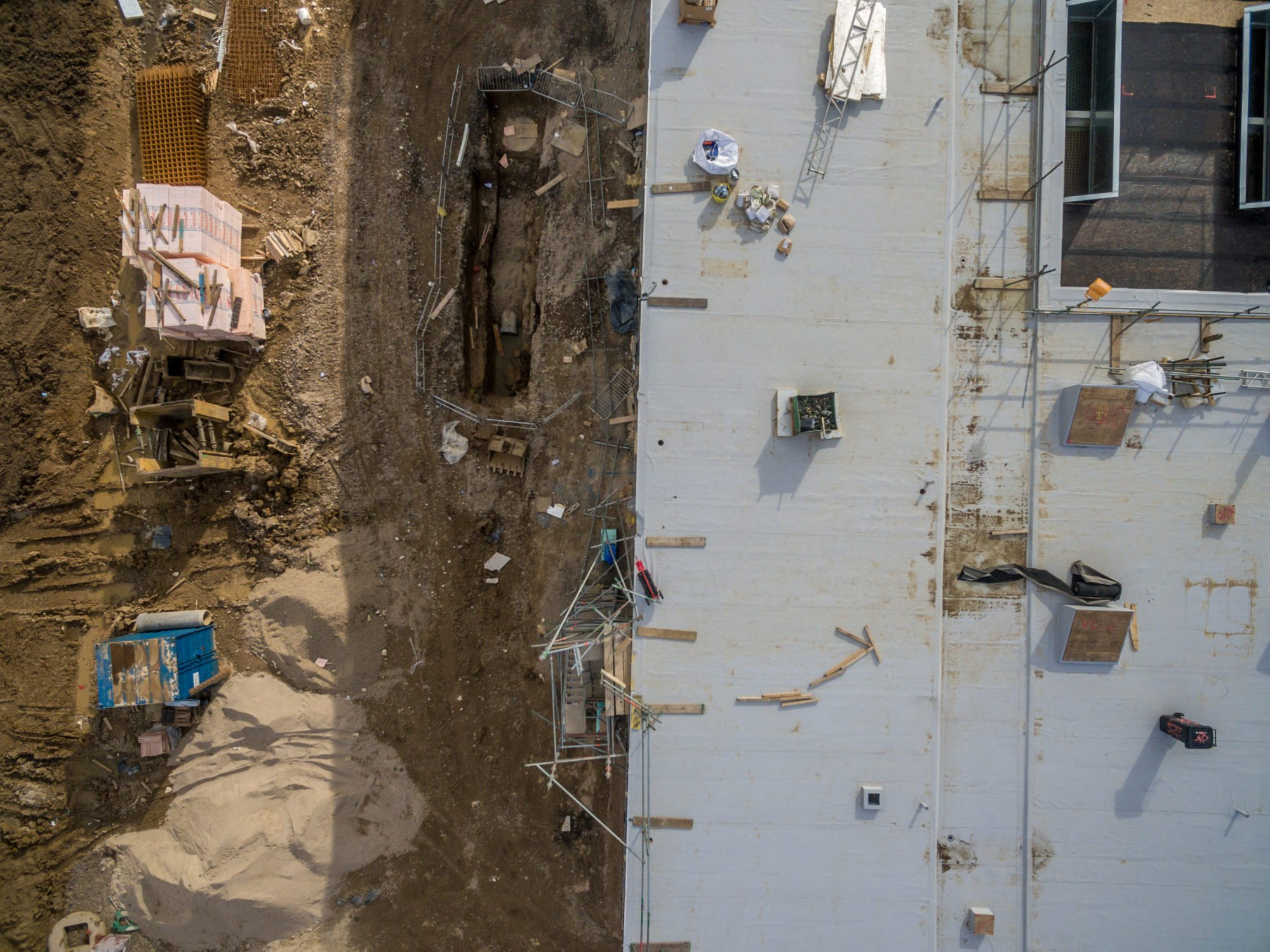 Aerial view of a drone inspection of building site damage due to extreme weather