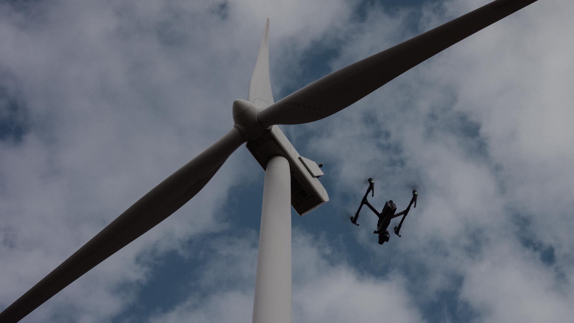 DJI Inspire 2 hovering infront of a wind turbine