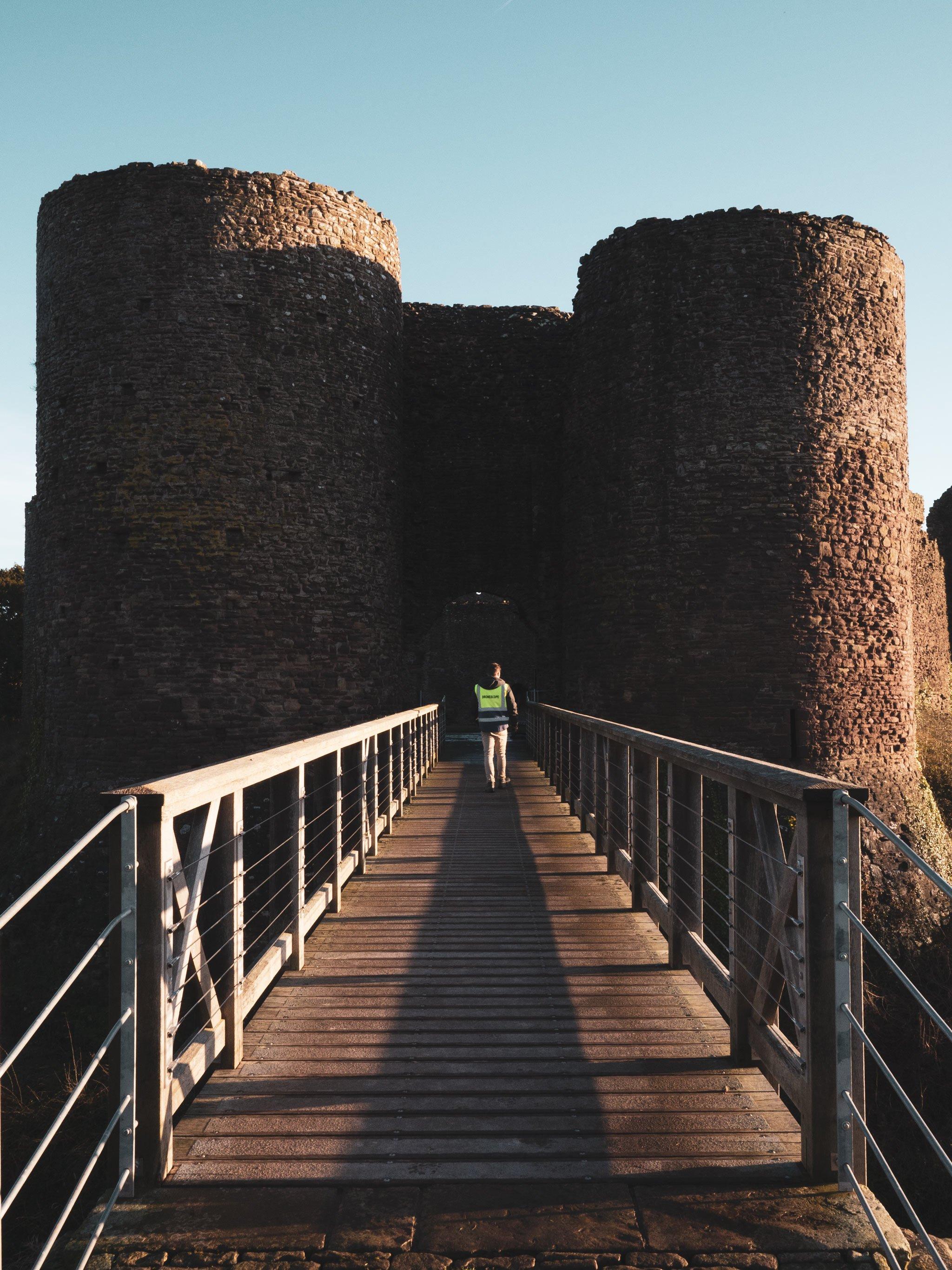 DroneScope crew crossing a bridge into a castle
