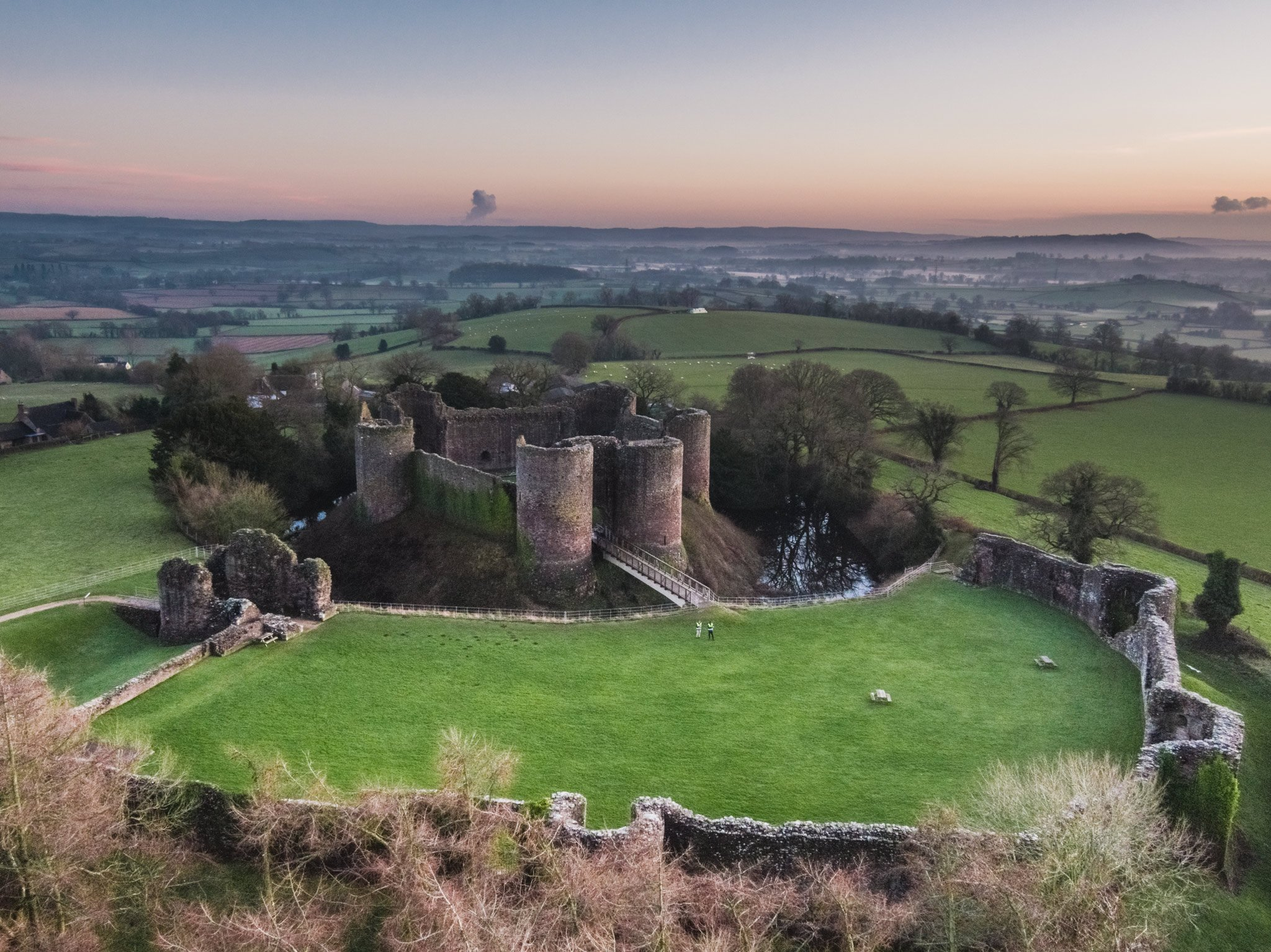 Aerial photography of a castle at sunset